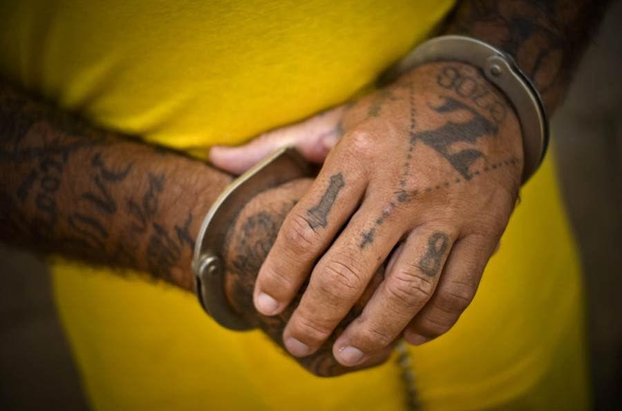 The handcuffed hands of a member of a gang known as Mara 18 in the prison yard at the Izalco jail in Sonsonate, El Salvador.