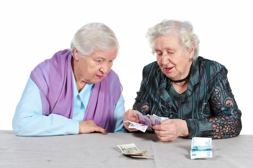 Two Grandma is counting Russian money. Isolated. Senior people series.